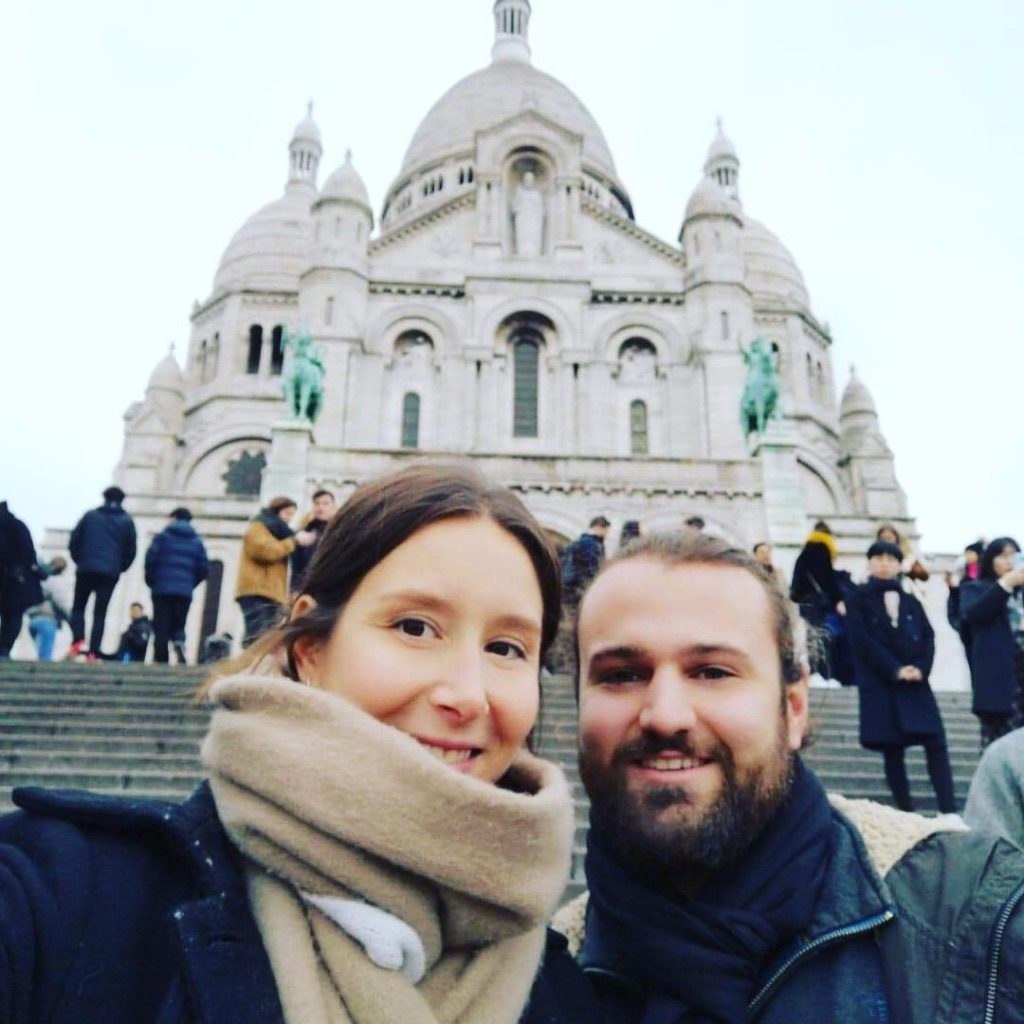 couple in front of Montmartre in Paris