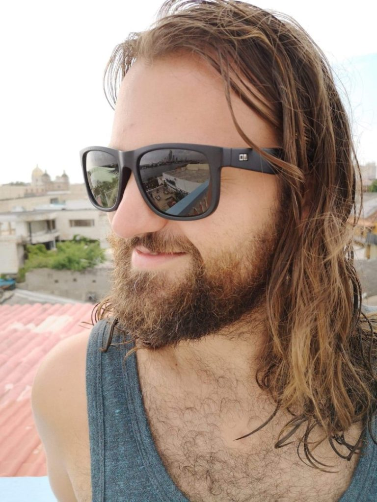 Hairy guy with sunglasses